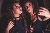 girls having selfie night club