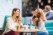 Girls having coffee break