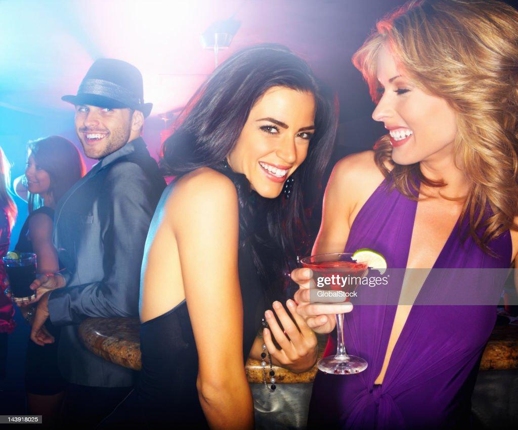 Girls having fun at a night club : Stock Photo