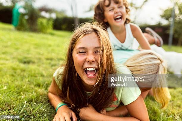 Girls having fun together on a meadow