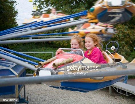 girls having joy ride on a fairground plane