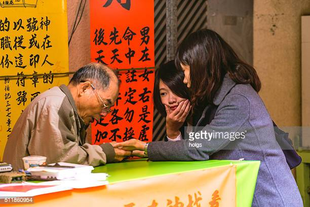 Girls having their palm read in Tainan, Taiwan