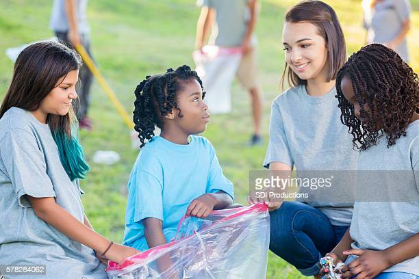 Girls help with community clean up in the park