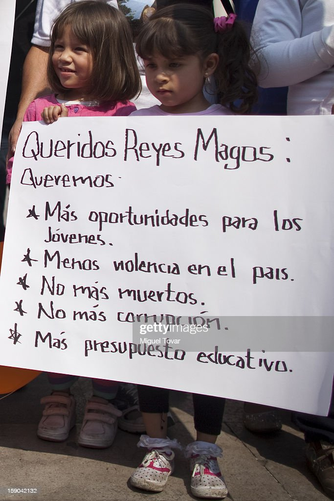 Girls hold a banner during a demonstration urging the Mexican government more opportunities for young people, less violence in the country, no more deaths, no more corruption and more budget for educationon January 05, 2013 in Mexico City, Mexico.