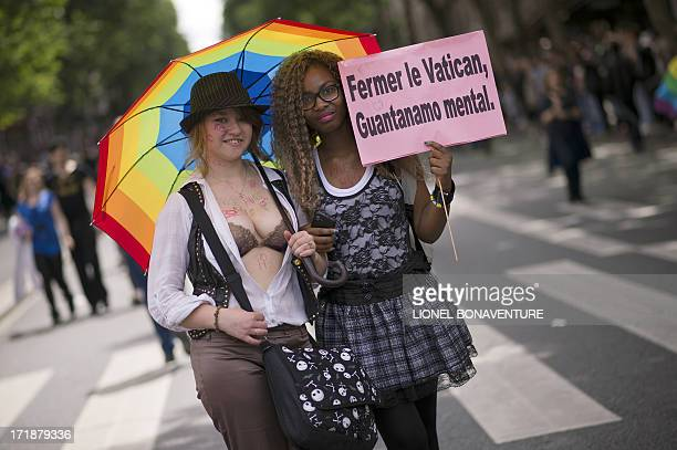 Girls hold a placard reading 'Close the Vatican' during the homosexual lesbian bisexual and transgender visibility march the Gay Pride on June 29...