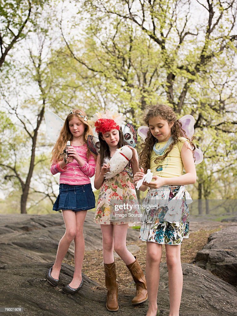 Girls holding fake birds : Stock Photo