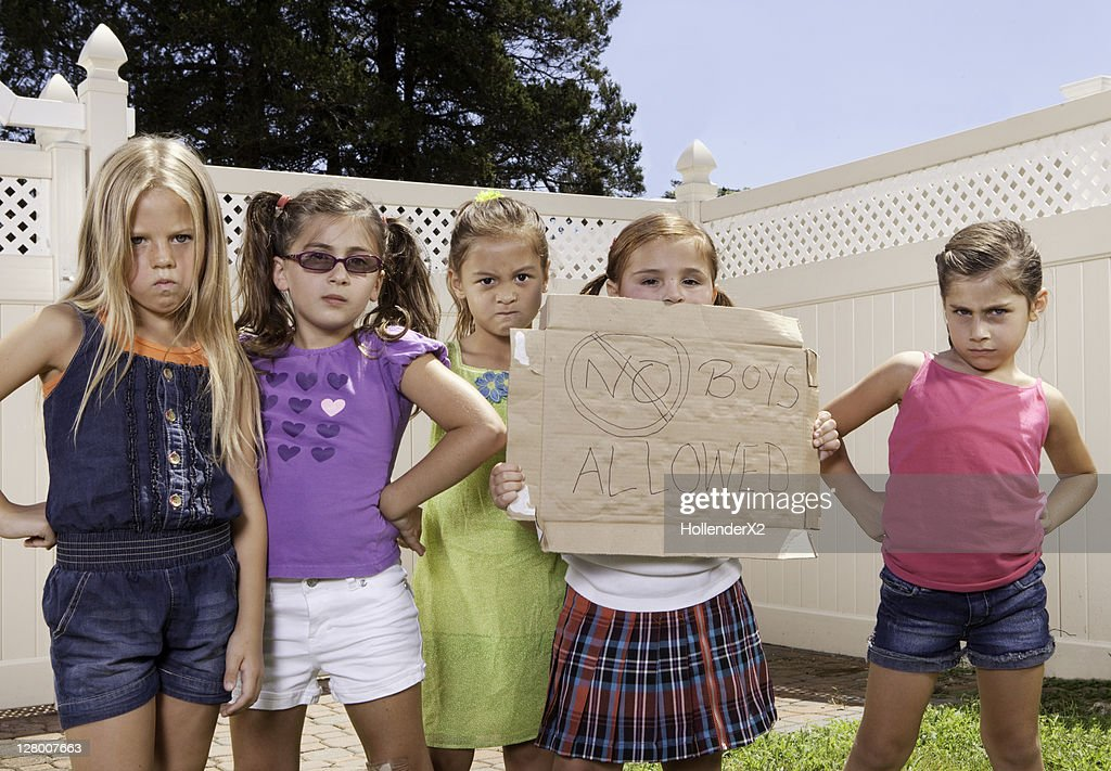 girls holding sign 'no boys allowed' : Stock Photo