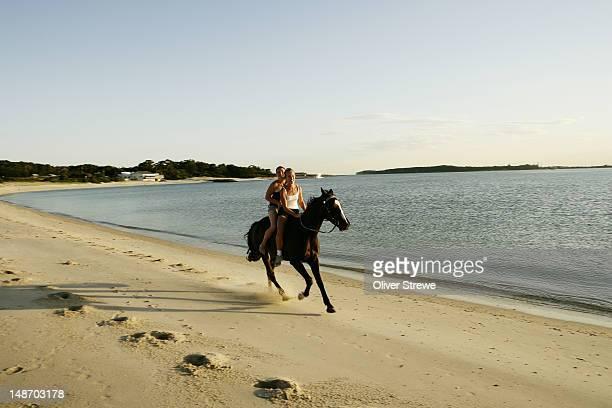 Girls horseriding on beach at Yarra Bay, Botany Bay.