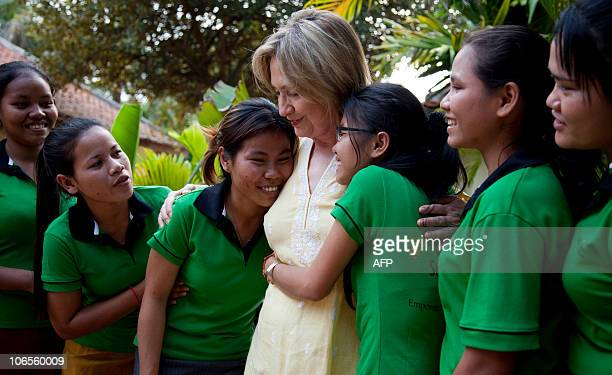 Girls hug US Secretary of State Hillary Rodham Clinton during a tour of the Siem Reap Center a shelter run by AFSEIP that provides rehabilitation...