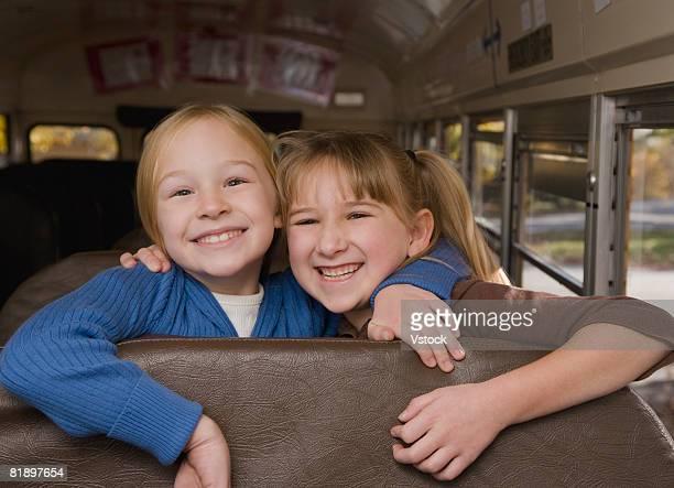 Girls hugging on school bus