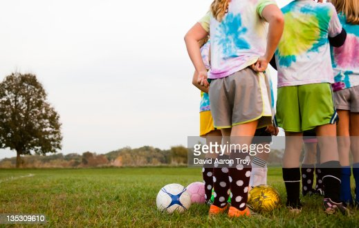 Girls in a huddle at soccer practice : Stock Photo
