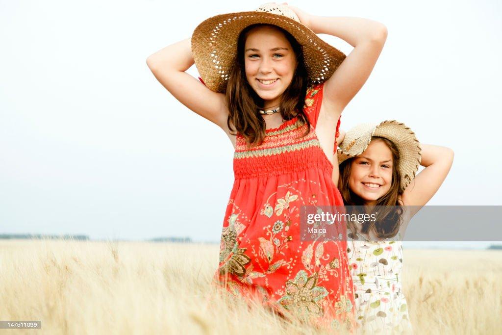 Girls in a wheat field : Stock Photo