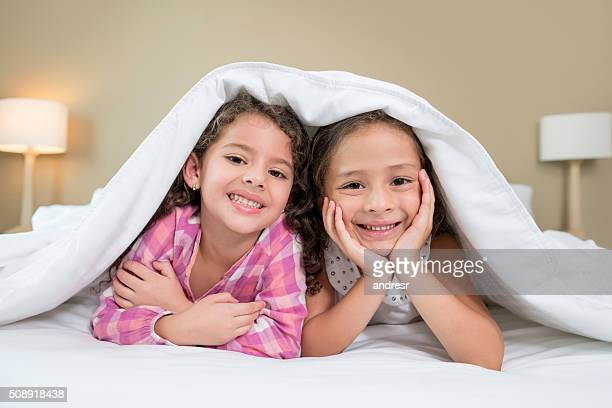 Girls in bed under the covers