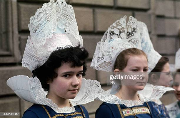 Girls in Breton traditional costume during the trip of the general OF GAULLE in Brittany