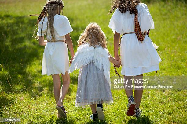 Girls in costumes walking outdoors