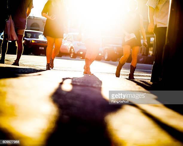 Girls in cowboy boots walking on Lower Broadway Street, Nashville