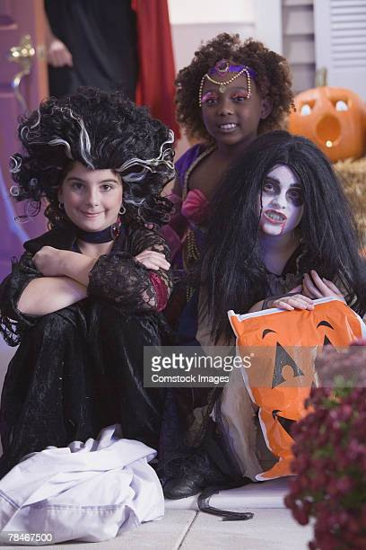 Girls in Halloween costumes sitting together