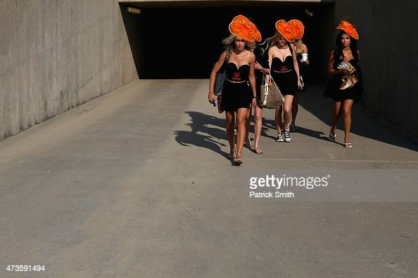 Girls in hats walk through the tunnel to the infield prior to the 140th running of the Preakness Stakes at Pimlico Race Course on May 16 2015 in...