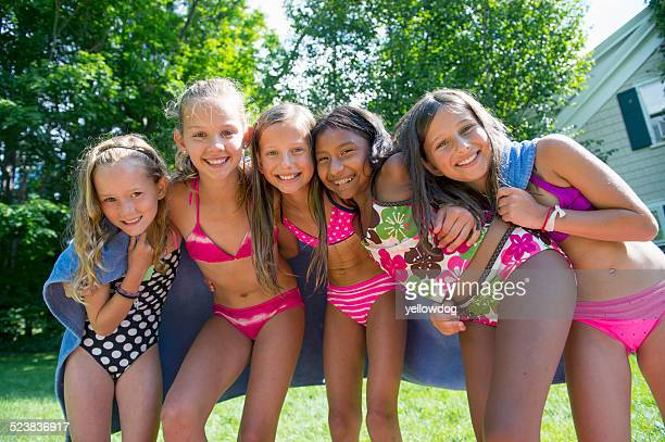 Girls in swimming costume wrapped in towel