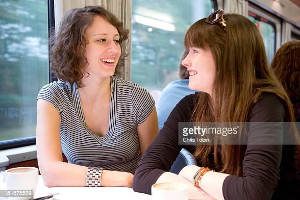 Girls in train dining car