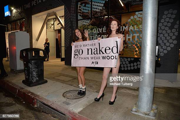 Girls inviting motorists to 'Go Naked' in support of PETA at the unveiling of Jhene Aiko's 'Rather Go Naked Than Wear Fur' ad at the opening night of...