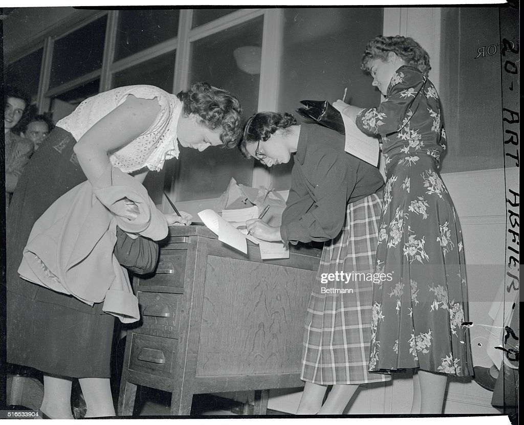 women filling out applications pictures getty images pictured out in the hall making out her application to join waves