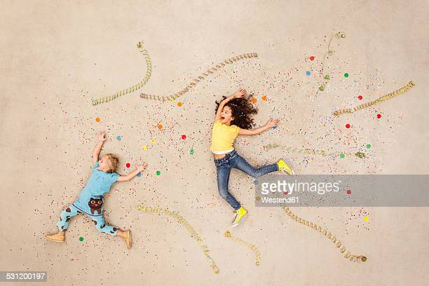 Girls jumping between streamers and confetti