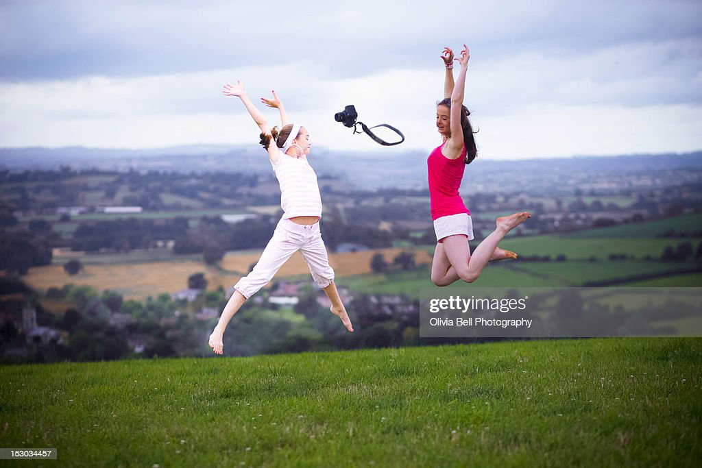Girls jumping : Stock Photo