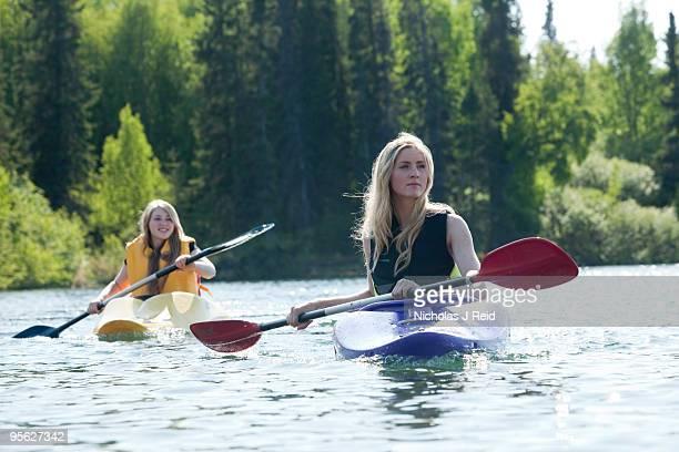 Girls kayaking on a lake