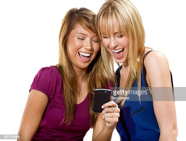 girls laughing and reading text message