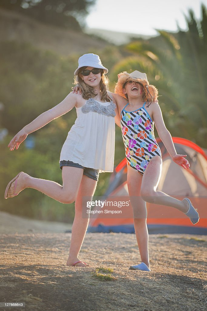 girls laughing at a campout : Stock Photo