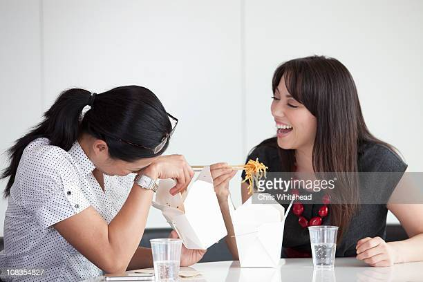 Girls laughing during lunch break
