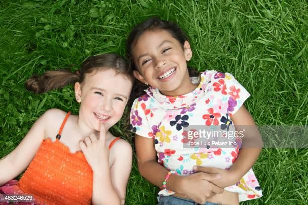 Girls laying in grass