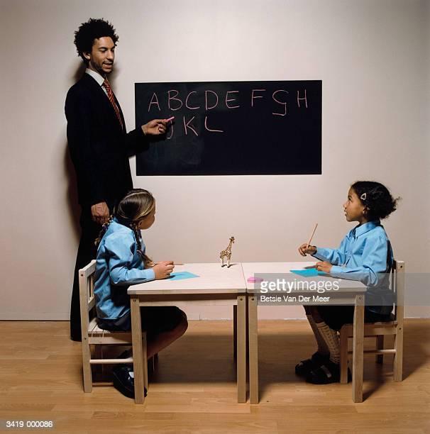 Girls Learning the Alphabet