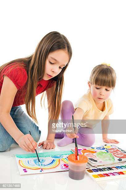 Girls Learning to Draw