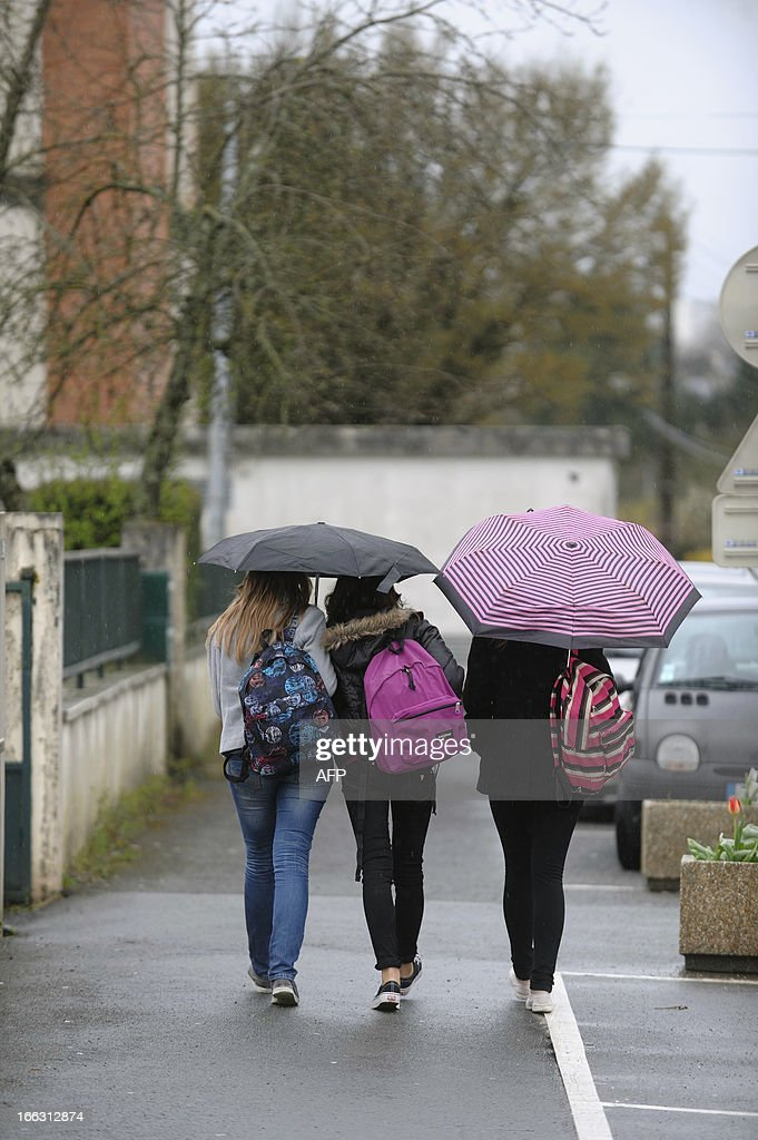 Girls leave after class on April 11, 2013 the Rene Couzinet college where an eleven years old girl was kidnapped after school and released a few hours later on April 10 2013 in Chantonnay, western France. A man was quickly arrested by the Fench gendarmes and confessed the crime according to the prosecutor of La Roche-sur-Yon.