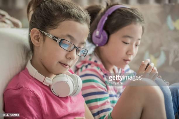 Girls listening to headphones
