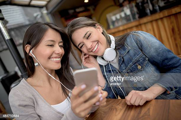 Girls listening to music at a coffee shop