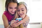 Girls listening to music laughing.