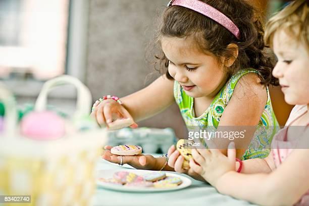 Girls Looking at Easter Egg Cookies