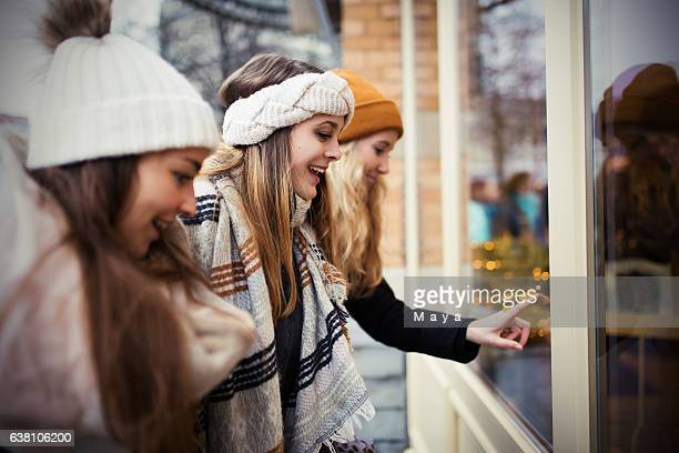 Girls looking at store window