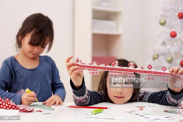 Girls making Christmas decorations