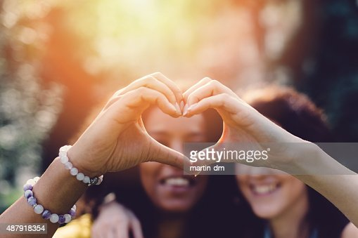 Girls making heart with hands