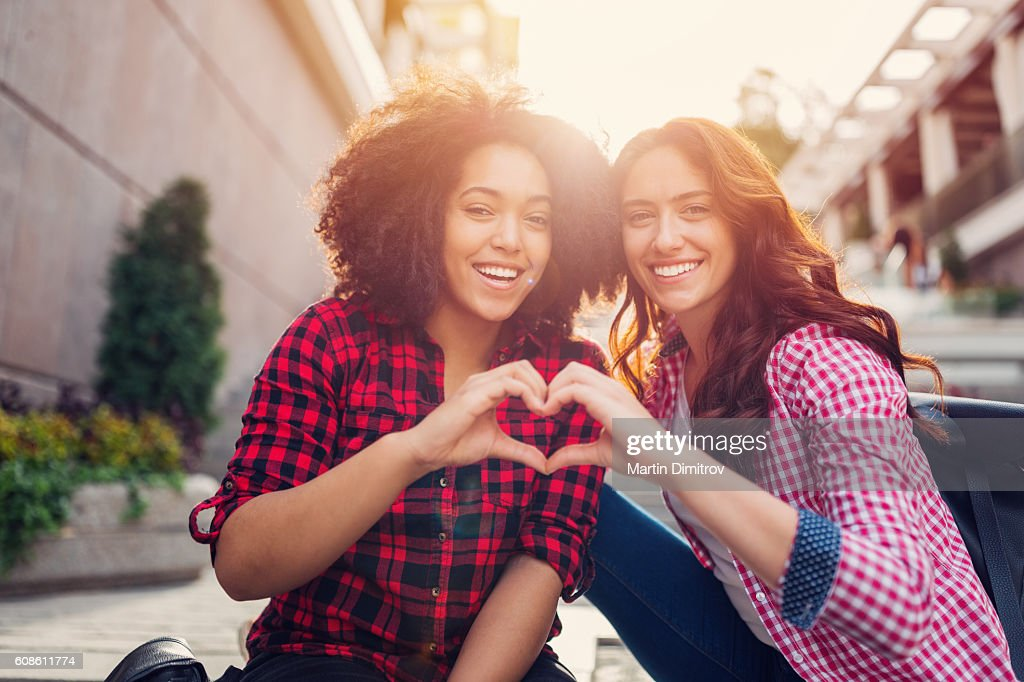 Girls making heart with hands : Stock Photo