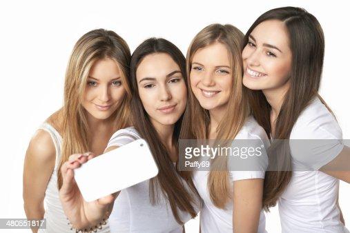Meninas fazendo Auto-retrato com smartphone : Foto de stock