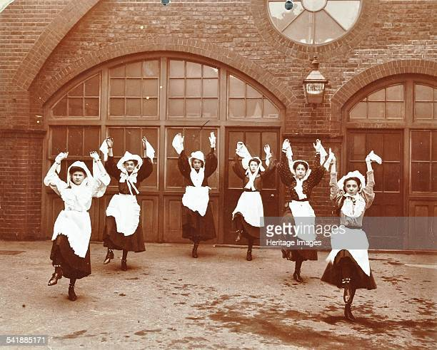 Girls morris dancing in playground Thomas Street Girls School Limehouse Stepney London 1908 A group of girls in traditional costume dance in the...