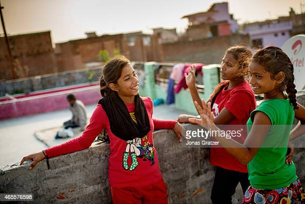 Girls of the Red Brigade wait on the roof of a house to learn selfdefense in a suburb called Madiyaon in the city of Lucknow in India The Red Brigade...