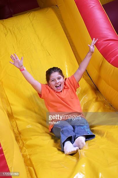 Girls on inflatable slide