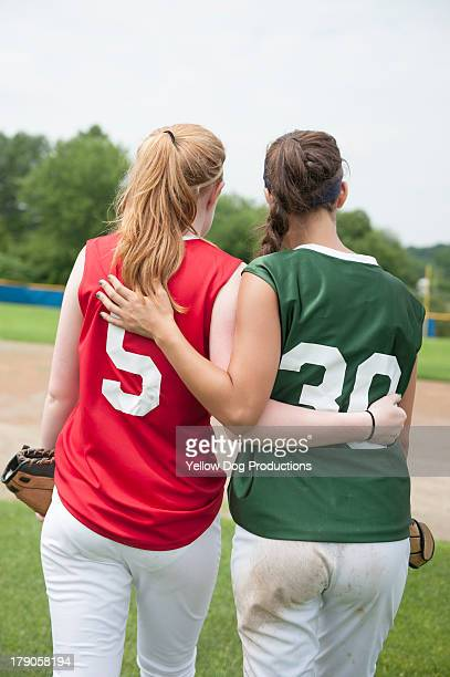 girls on opposing teams walking off field together