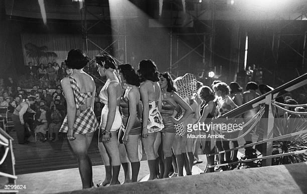 Girls on stage for a beauty parade in the film 'Lady Godiva Rides Again' a satirical comedy based on contestants in a beauty contest The film was...